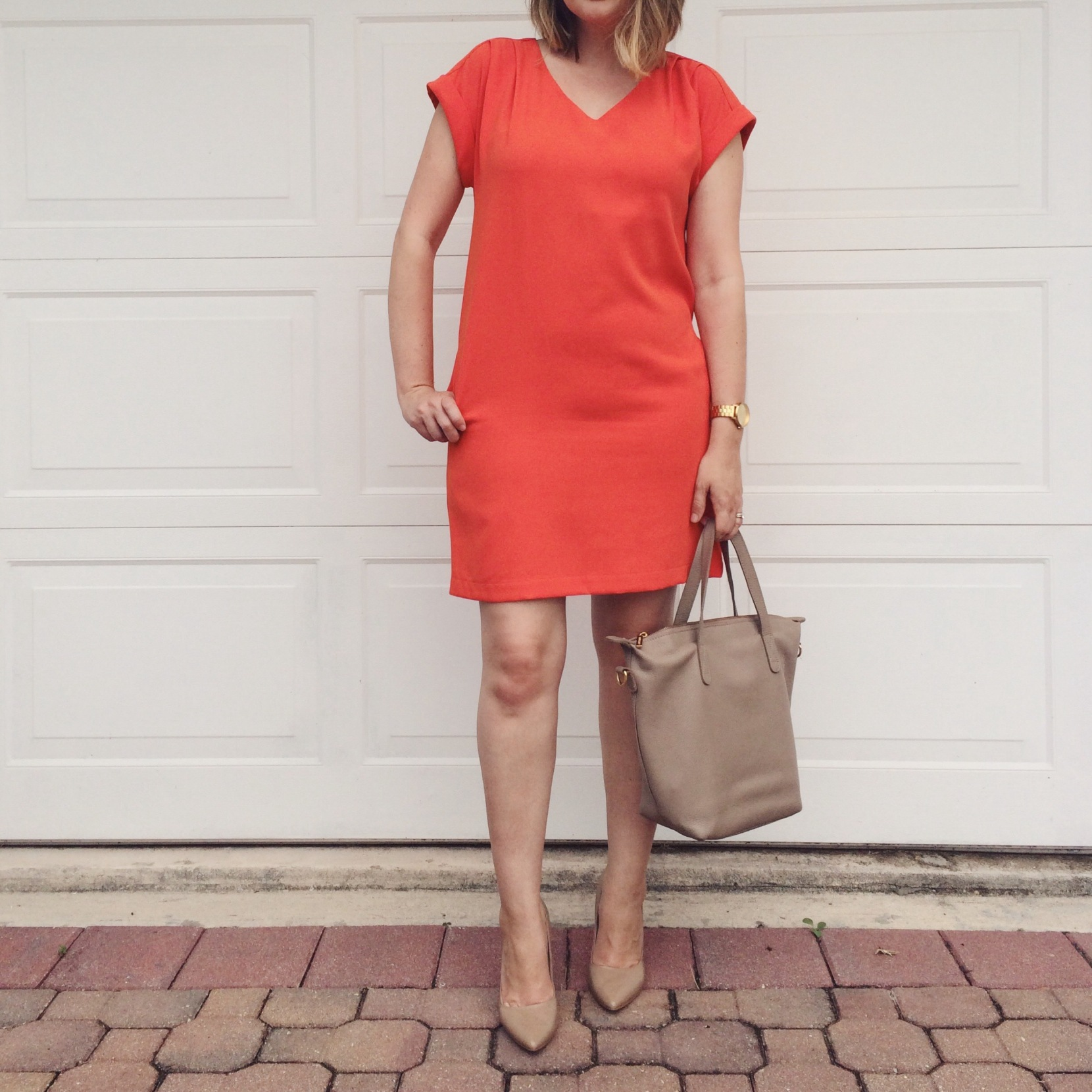 OOTD: Bright orange dress with nude heels and Cuyana small carryall tote. keiralennox.com